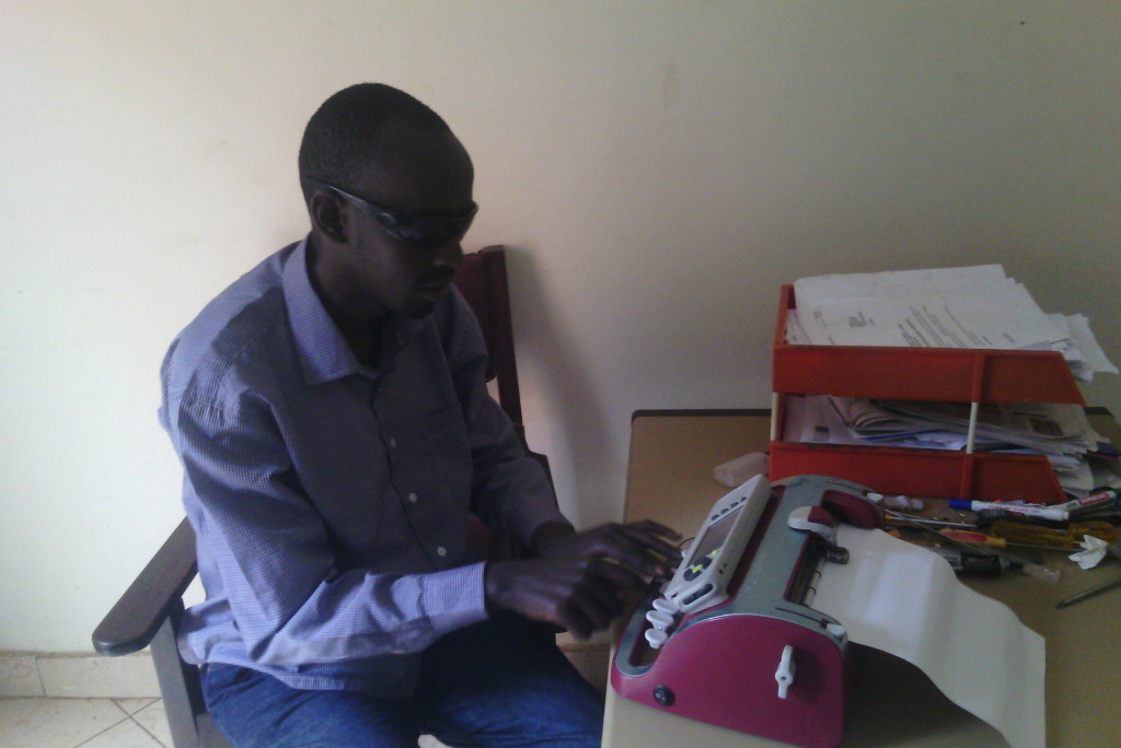 Blind student of Nsamizi college testing the SMART brailler