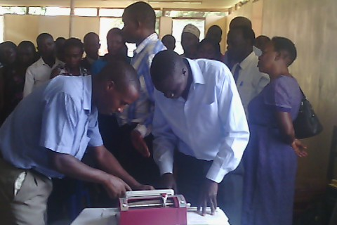 Teachers for special needs education in Kampala District admiring the SMART brailler